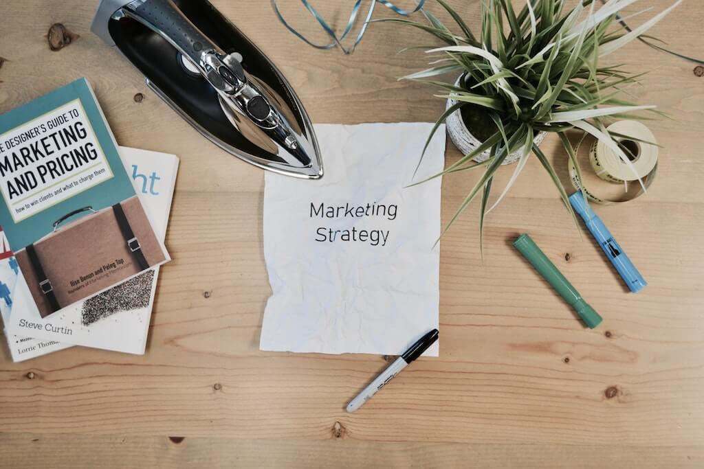 Marketing strategy written on paper