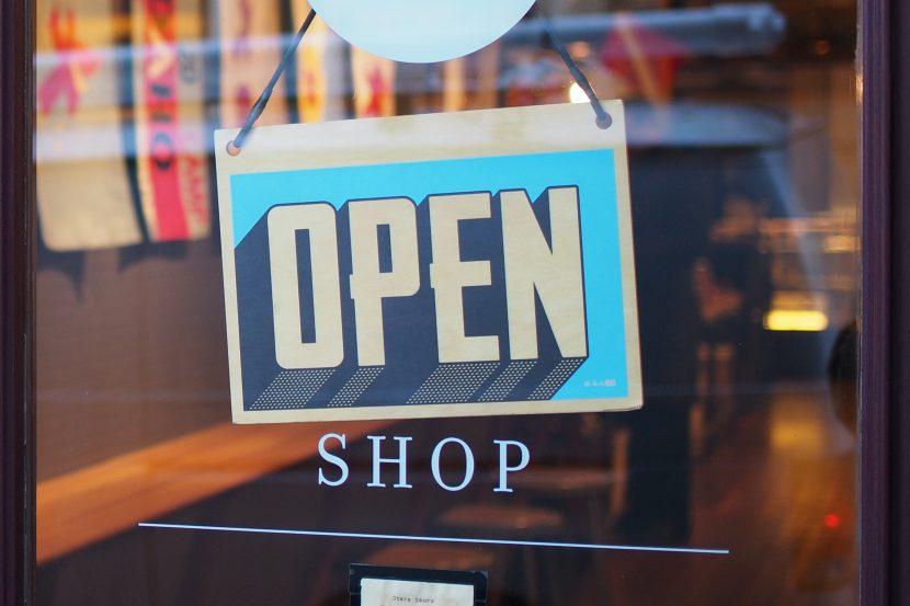 open shop sign on glass door